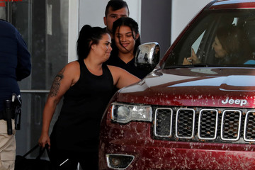 Isabela, an asylum seeker from El Salvador, leaves Casa Esperanza, a federal contracted shelter, with her 17-year-old daughter Dayana in Brownsville