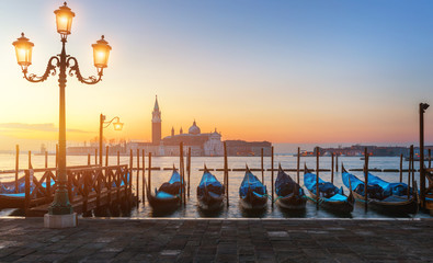 Sunrise in San Marco square, Venice, Italy. Venice Grand Canal. Architecture and landmarks of Venice. Venice postcard with Venice gondolas