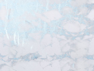 Icy silver marble background. Shiny, glitter and glossy effect for an elegant and feminine wallpaper.