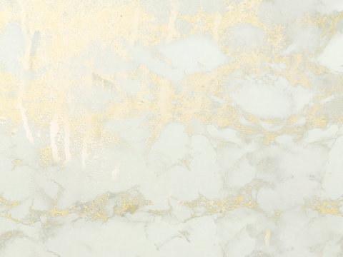 Gold marble background. Shiny, glitter and glossy effect for an elegant wallpaper.