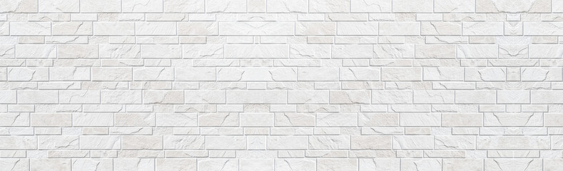 Panorama of white modern stone wall pattern and background