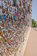 Locks signifying a couples love for one another on a bridge's chain fence in Pittsburgh, Pennsylvania, USA