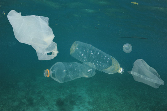 Plastic bags and bottles pollution underwater in ocean