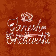 Ganesh Chaturthi. Indian festival. Handmade text. Elephant head, paisley, dagger, lotus. Dark grunge background