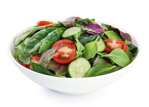Fresh green salad with tomatoes isolated on white background.