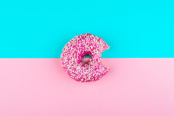 one pink isolated donut on a mint and pink background
