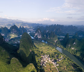aerial view of farmland and mountain around the ancient town of Xingping, China