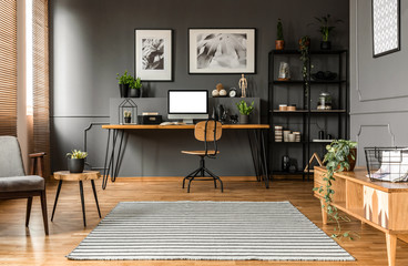 Grey living room with workspace