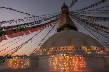 Boudhanath Stupa decorated with prayer flags and lights for the full moon festival, evening light, Boudhanath, UNESC World Heritage Site, Kathmandu, Nepal, Asia
