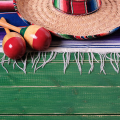 Mexico cinco de mayo wood background mexican sombrero square format