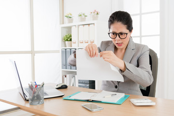 female business lady tear off the report