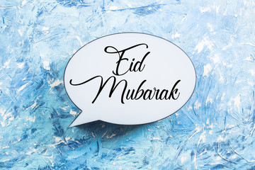 Eid Mubarak Text on Blue Background