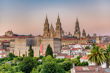 Hazy sunset on monumental Santiago de Compostela cathedral. Wall mural