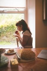 Woman having a tea at home