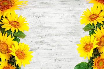 Fototapete - Beautiful sunflowers on a wooden table. View from above. Background with copy space.