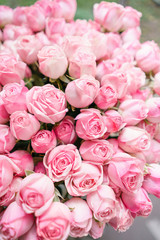 light pink bush roses flowers in vase on wooden table. Beautiful summer bouquet. Arrangement with mix flowers. The concept of a flower shop. Content for the catalog