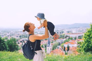 Woman and child on background of Ljubljana City, Slovenia. Travel Europe.
