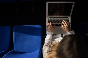 Woman using laptop in cruise ship