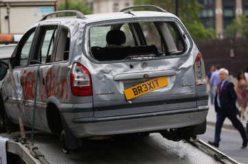 Pro-EU campaign group 'Open Britain' drive a broken car around Parliament Square on a low loader, as the government release their Brexit 'White Paper', in Westminster, London