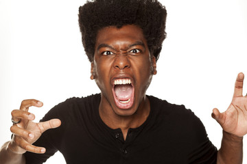 Portrait of young aggressive african american man  on white background