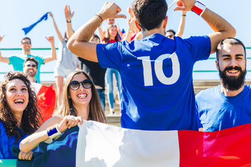 Happy French fans at stadium for football match