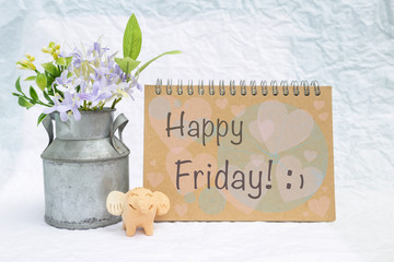Happy Friday card with happy elephant clay and tin flower pot over blurred white background