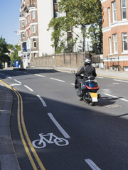 Man riding moped in helmet