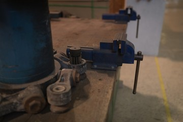 Vise tool on a wooden table