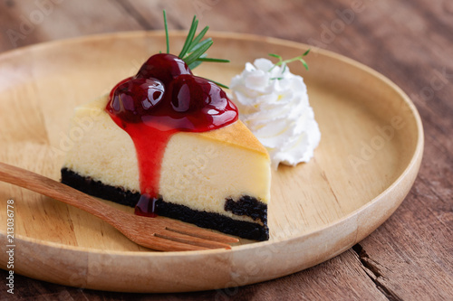 Delicious And Sweet Strawberry New York Cheesecake On Wooden Plate Served With Whipped Cream Wood