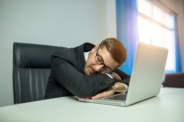 Businessman employee sleep relaxing in office
