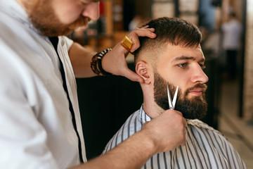 Beard Cut In Barber Shop. Barber Cutting Beard