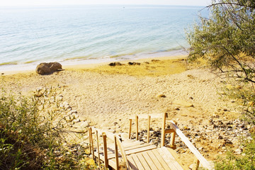 Wooden staircase to the sea, made of old pallets - ecological material.