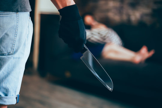Wicked and evil murderer attempt to kill a woman in danger with a knife - homicide and violence society problem concept.