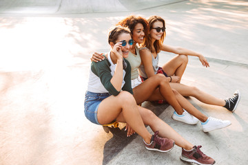 Three laughing pretty young girls having fun