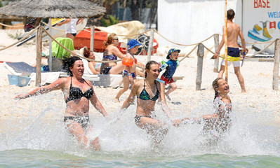 Tourists cool off on the Jaz Tour Khalef Hotel beach in Sousse