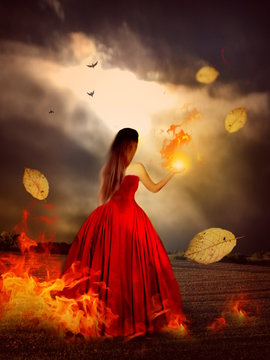 Woman in red dress with magical fire