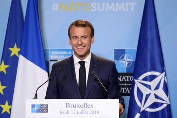 French President Emmanuel Macron addresses a press conference on the second day of the North Atlantic Treaty Organization (NATO) summit in Brussels