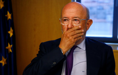 Former chairman of Banco Popular Saracho covers his mouth in parliament in Madrid