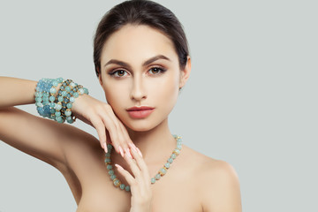 Pretty Young Woman with Makeup, Manicure Jewelry Bracelet and Necklace