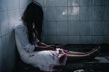 Ghost woman holding knifer. Halloween.