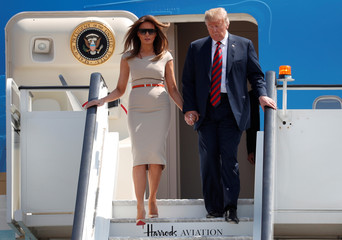 U.S. President Donald Trump and first lady Melania Trump arrive at Stansted Airport