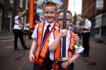 William McGrath aged 7 and Christopher McGrath aged 6 hold a sword as they participate in Loyalist Orders Twelfth of July celebrations in Belfast
