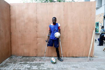 Amputee football player Mohammed Umar poses for a portrait photograph after a training session at the national stadium in Surulere district in Lagos