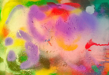traces of aerosol paints of different colors multicolored textural background