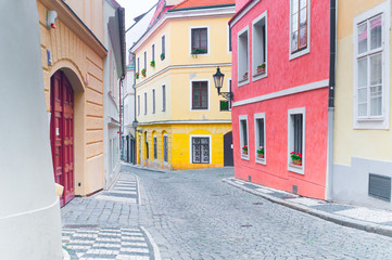 Empty narrow cobblestone street in downtown in Prague, Czech Republic