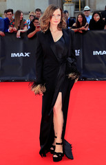 """Cast member Rebecca Ferguson poses during a photocall for the world premiere of """"Mission: Impossible - Fallout"""" in Paris"""