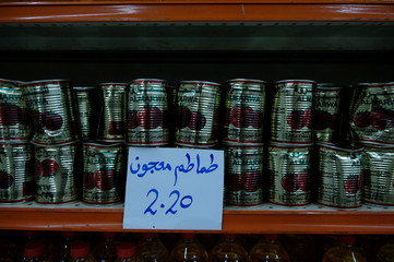 Canned tomatoes are seen in a mall in Benghazi