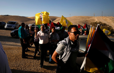 Palestinians arrive to participate in a meeting of Fatah Revolutionary Council at the Bedouin village of Khan al-Ahmar in the occupied West Bank