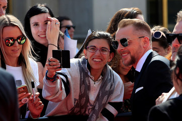 "Cast member Simon Pegg poses for cinema fans as he arrives to attend the world premiere of ""Mission: Impossible - Fallout"" in Paris"
