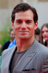 """Cast member Henry Cavill poses during a photocall for the world premiere of the film """"Mission: Impossible - Fallout"""" in Paris"""